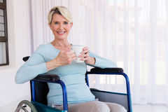 Handicapped senior woman coffee Royalty Free Stock Photography