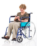 Handicapped senior woman smart phone Stock Image