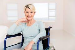 Handicapped senior woman wheelchair stock image