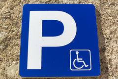 Handicapped sign. Traffic signal on a wall with a disabled parking Stock Photos