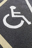 Handicapped sign on asphalt Stock Images