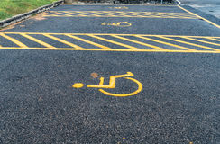 Handicapped sign in car park Royalty Free Stock Images