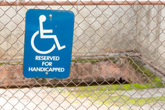 Handicapped sign in front of pit in ground Royalty Free Stock Images