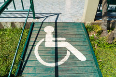 Handicapped sign on pathway Royalty Free Stock Images