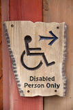 A handicapped sign on wood wall Stock Images