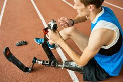 Handicapped Sportsman Repairing Prosthetic Leg royalty free stock photos