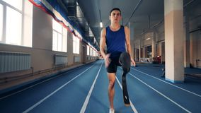 Handicapped sprinter training on a track, bionic prosthesis. 4K stock video footage