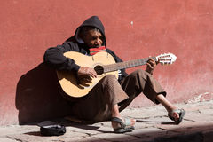 Handicapped street musician in Mexico. January 27, 2016 San Miguel de Allende, Mexico: handicapped street musician playing for donations in the street Royalty Free Stock Photos