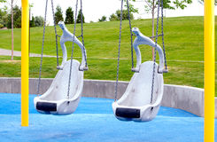 Handicapped swings on playground Stock Image