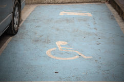 Handicapped Symbol Painted on a Parking Spot Royalty Free Stock Images