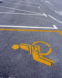 Handicapped symbol on a parking Stock Image