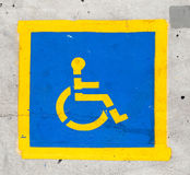 Handicapped symbol on parking space Stock Photo