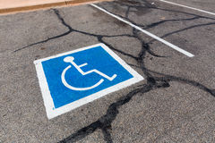 Handicapped symbol on a parking spot. Stock Photo