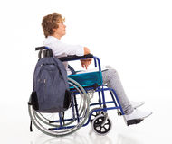 Handicapped teen boy. Side view of handicapped teen boy sitting on wheelchair stock images