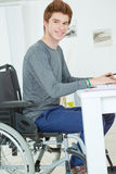 Handicapped teenager doing homework Royalty Free Stock Photography