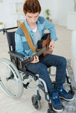 Handicapped teenager playing guitar Royalty Free Stock Photography