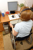 Handicapped telemarketer. Handicapped woman on wheelchair working at home as telemarketer stock images