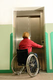 Handicapped using elevator Royalty Free Stock Photography