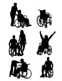 Handicapped and wheelchair Silhouettes Royalty Free Stock Photos