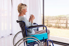 Handicapped woman drinking coffee Stock Image