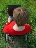 Handicapped woman with laptop Royalty Free Stock Photo