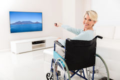 Handicapped woman watching tv Stock Photo