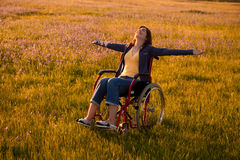 Handicapped woman on wheelchair Royalty Free Stock Photos