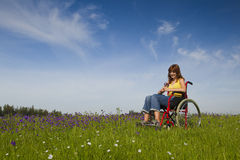 Handicapped woman on wheelchair Royalty Free Stock Images