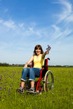Handicapped woman on wheelchair Stock Photography