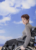 Handicapped woman in wheelchair at the beach Royalty Free Stock Photo