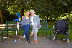 Handicapped women on a park bench Stock Photos