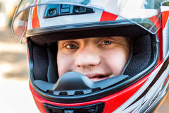 Handicapped young man wearing helmet. Stock Image