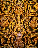 Handicraft. Ancient traditional Thai pattern on the door surface royalty free stock photography
