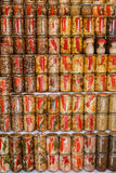 Handicraft canned jars with mushrooms, paprika and other vegetables are stand on the shelf stock images