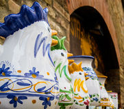 Handicraft ceramic cockerels. Handicraft products, colorful ceramic cockerels in San Gimignano Royalty Free Stock Image