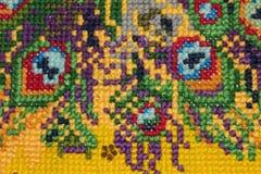Handicraft, cross-stitch, beautiful bright background royalty free stock photo