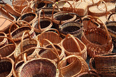 Handicraft in Europe. Outdoor market stall with wicker baskets. Handicraft in Poland Royalty Free Stock Images