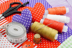 Handicraft hearts, fabric materials and items for sewing Stock Images
