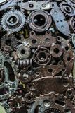 Handicraft metal artwork from used spare parts. Handicraft metal artwork from used car parts stock photography