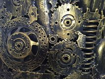 Handicraft metal artwork from used spare parts.Scraps part, metal gears, car, auto, motorcycle etc. Royalty Free Stock Photography