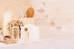 Handicraft natural cosmetics - white cream, oil, towel and bath accessories on soft light beige wood table, copy space. Handicraft natural cosmetics - white royalty free stock image
