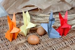 Handicraft origami rabbits from paper. Easter bunnies.  royalty free stock photography