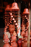 Handicraft pottery wind chimes. Elegant pottery wind chimes in the shape of bells on sale at a roadside stall in Sri Lanka Stock Photos