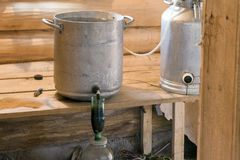 Handicraft production of alcohol. Moonshine. Manufacture of moonshine in Russia stock images
