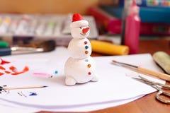 Handicraft snowman figurine Stock Photos