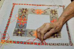 Handicraft. An 91 years old woman sew lining to cushion. No matter what age we have always something to do Stock Images