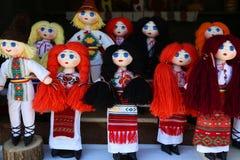 Handicrafts dolls. Dressed in romanian peasant costumes stock photos