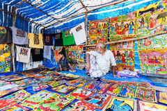 Handicrafts are perpared for sale by rural Indian man and child in Pingla village, India Royalty Free Stock Image