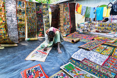 Handicrafts are perpared for sale by rural Indian man. Royalty Free Stock Photography