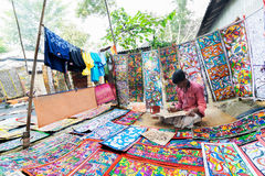 Handicrafts are perpared for sale by rural Indian man. Royalty Free Stock Photo
